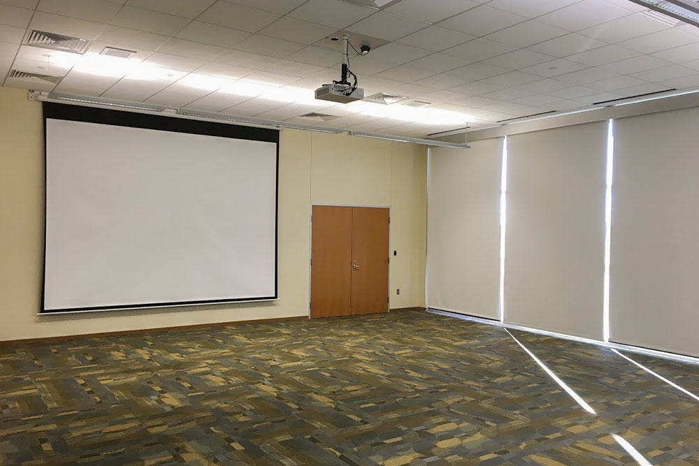Meeting room with projector and window screens closed